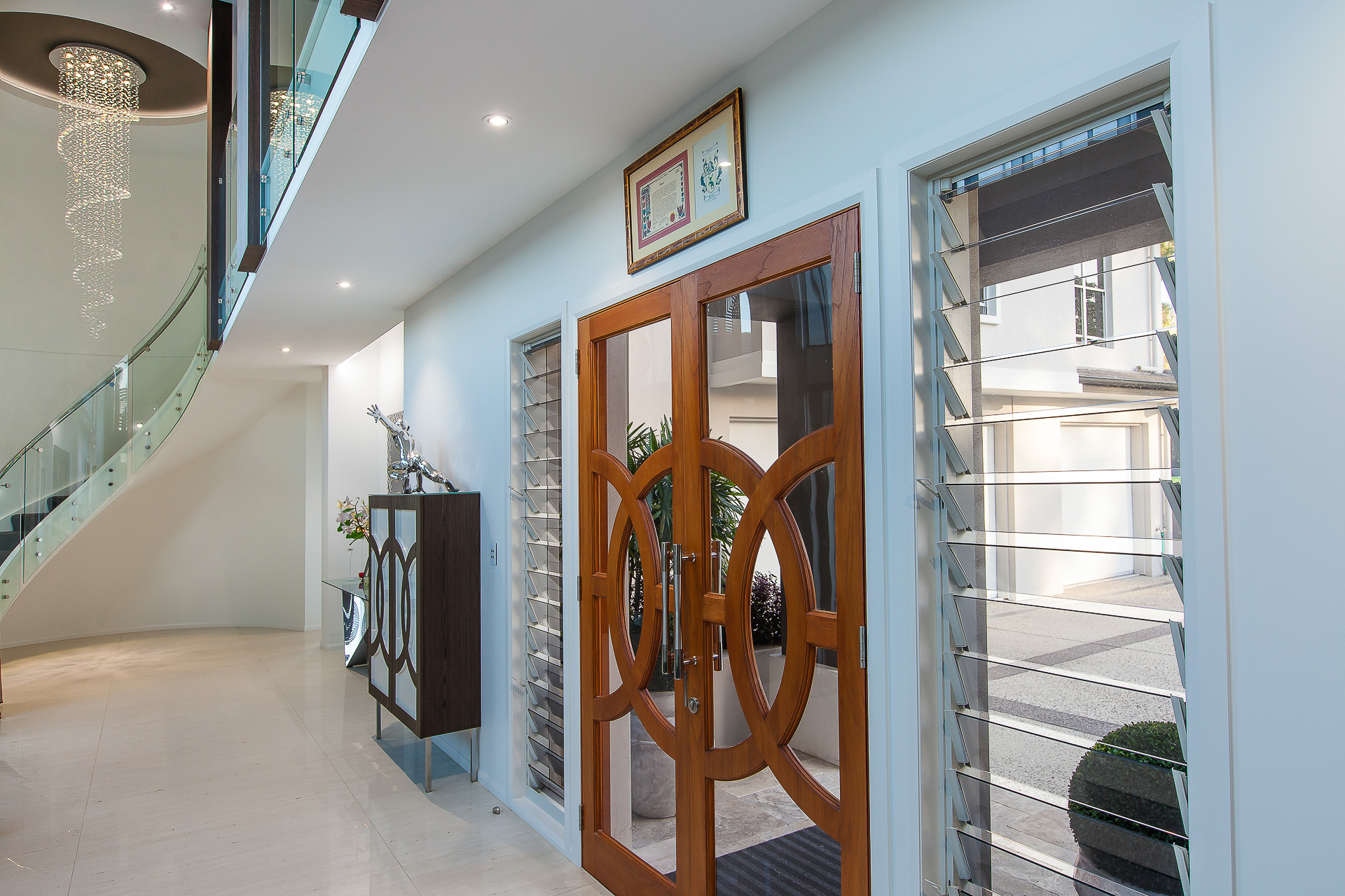 Luxury home, entry, spiral staircase, chic, classy, marble tiles, custom furniture, cinema doors, minka joinery
