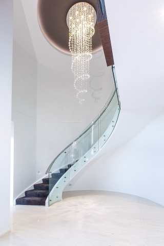 Luxury home, spiral staircase, stairs, chandelier, spiral lights, curved glass, stunning entry, minka joinery