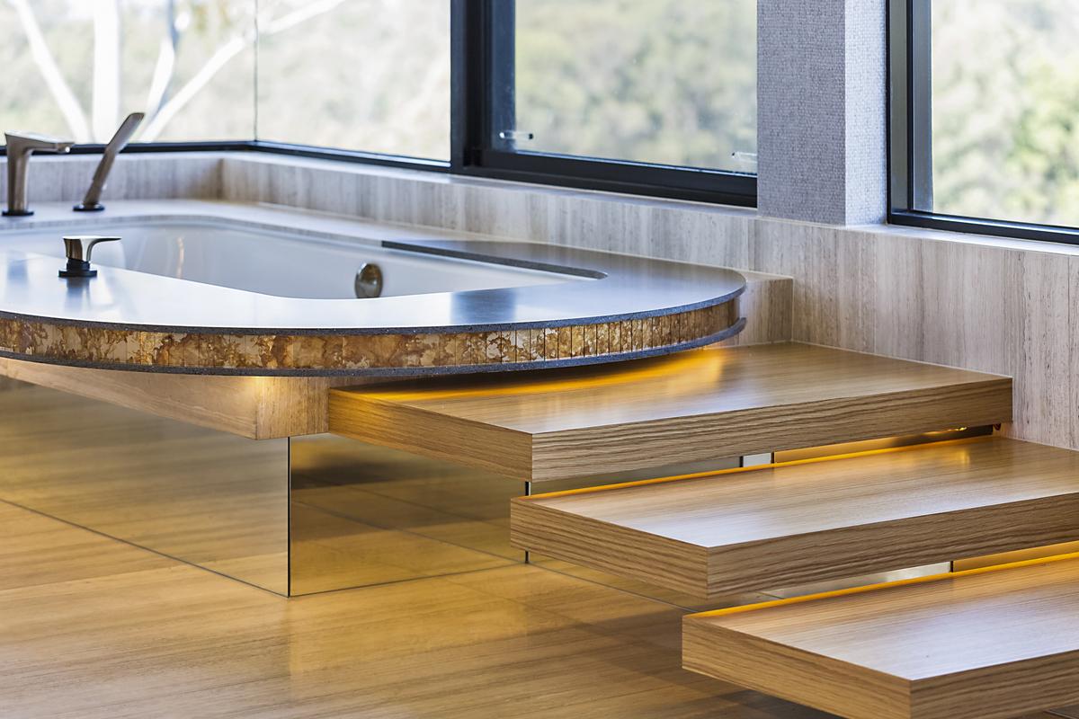 corian lava rock bath surround, luxury bathroom, best bath tub, bath steps, floating steps, led lighting, minka joinery