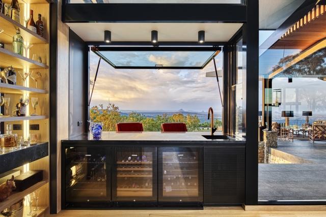 luxury bar, spirits bar, vintec, marble benchtop, back lit spirit display, drinks bar, wine fridge, awning window, minka joinery