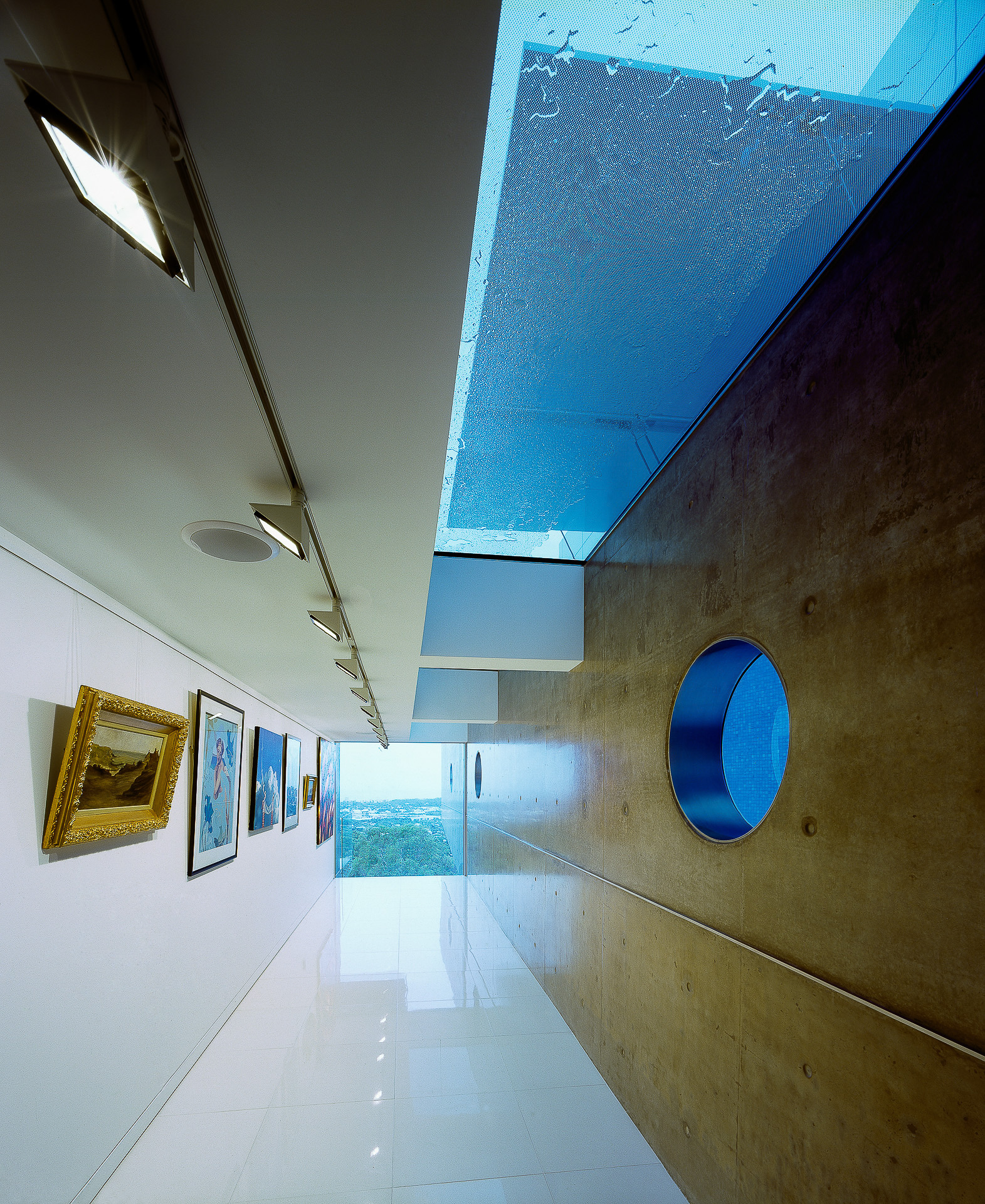 art room, art show, minimal, polished concrete walls, port hole, futuristic, minka joinery