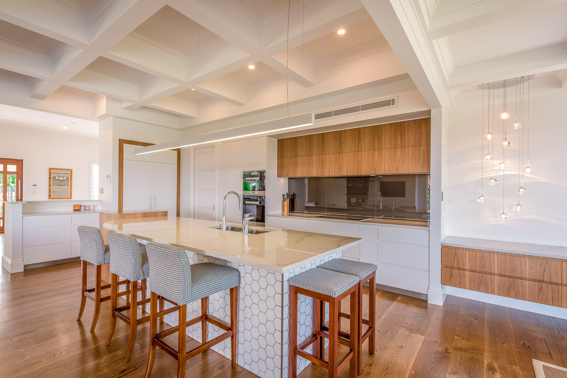 Luxury kitchen, integrated fridge, white granite, miele, luxury interiors, minka joinery, Cowan Constructions, brisbane, queensland