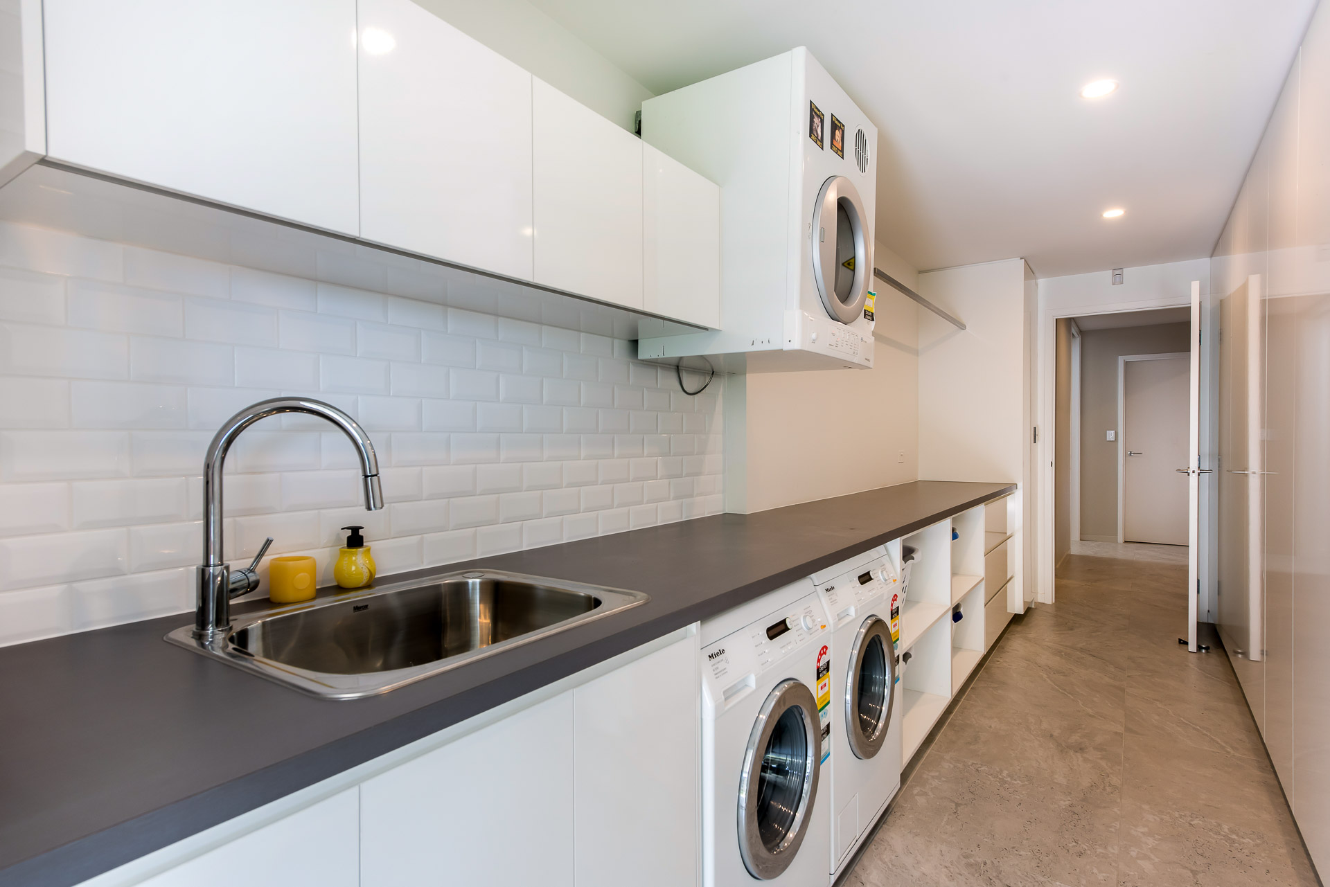 laundry, galley laundry, subway tiles, splashback, white 2 pack cabinets, minka joinery